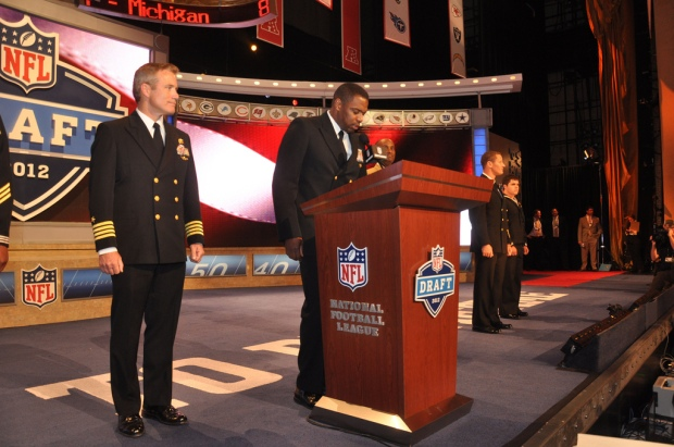 A sailor announces a pick at the 2012 NFL Draft