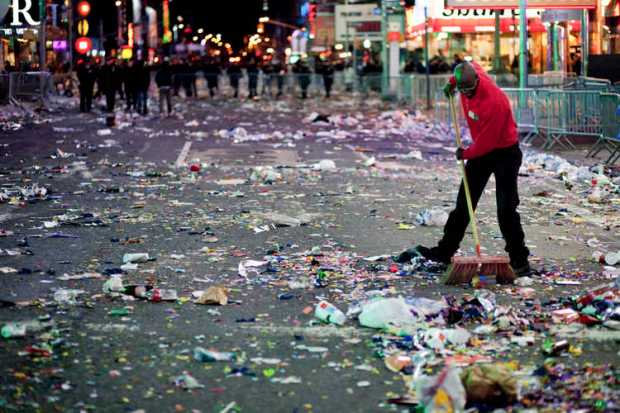 A worker begins sweeping Times Square after New Year's Eve celebrations ended in New York.